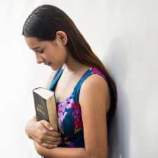 A young woman with a Bible