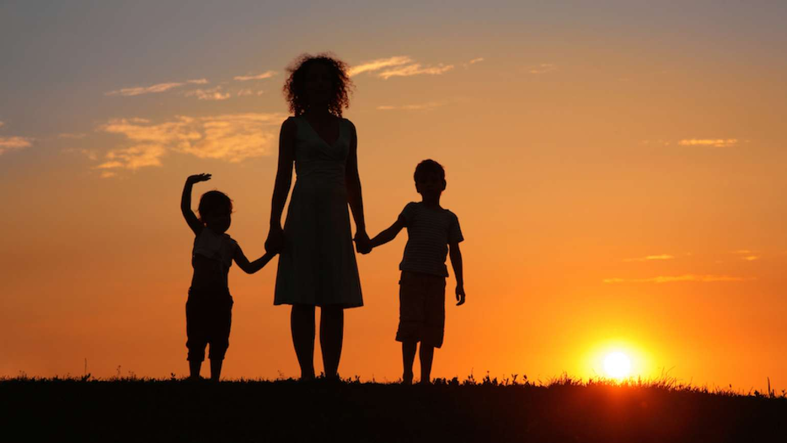 A mother and her children (Shutterstock)