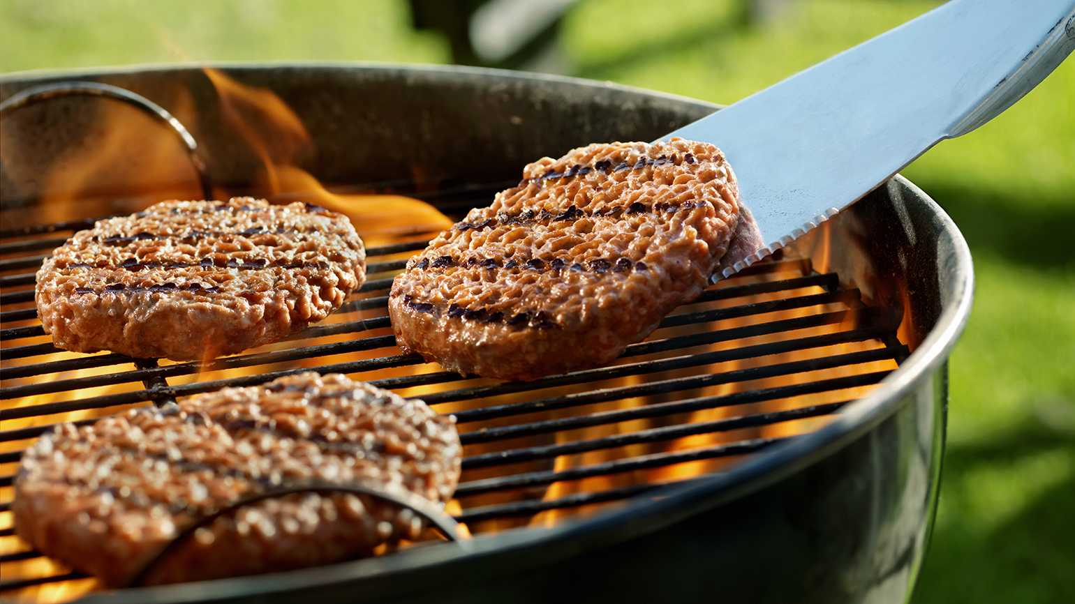 Hamburgers on an outdoor grill