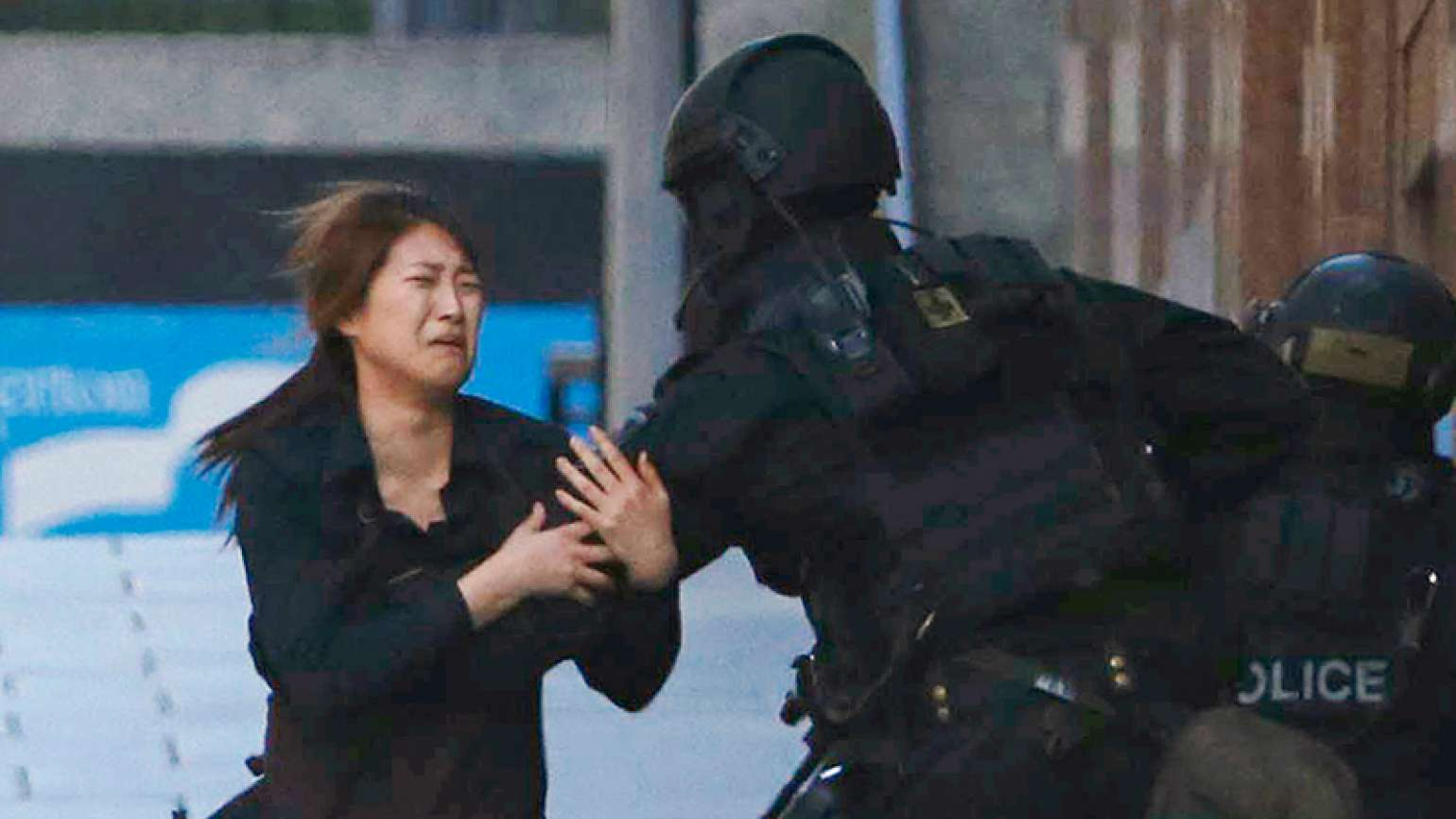Australian hostage escapes into a policeman's arms