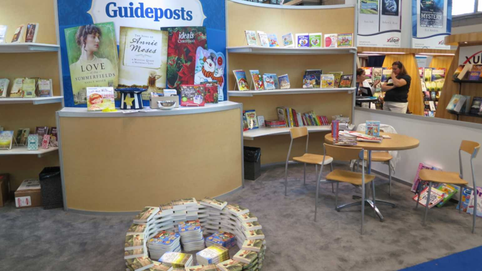 The Guideposts booth at Book Expo America, with piles and displays of books