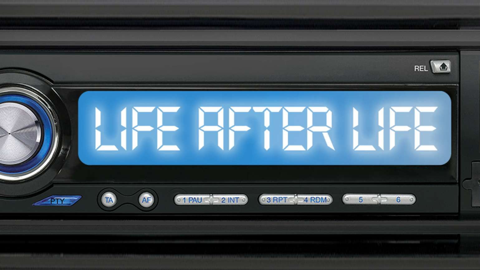 """A car radio dial with the words """"Life After Life"""" on it"""