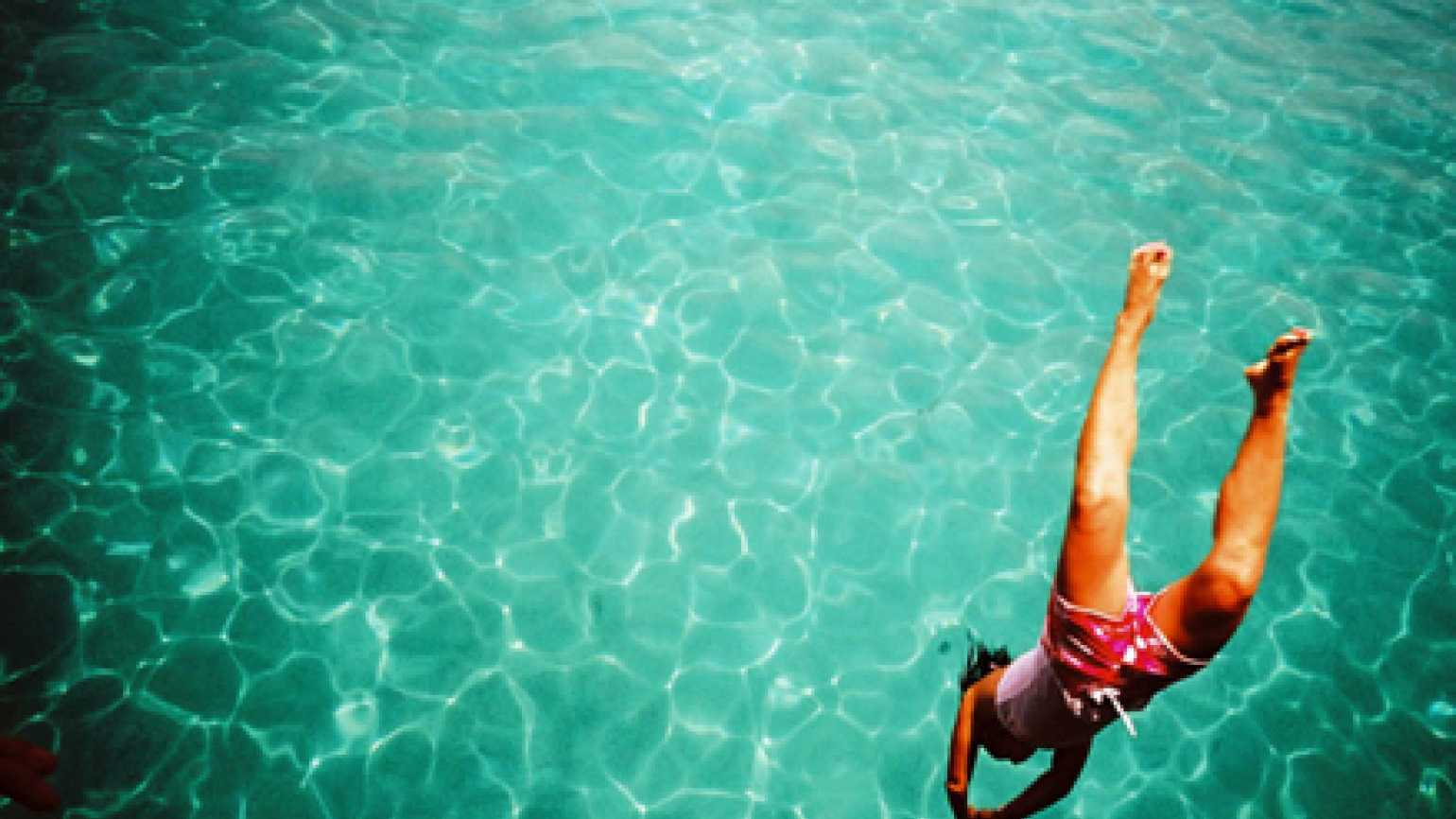 A woman diving into beautiful water -- an image of positivity