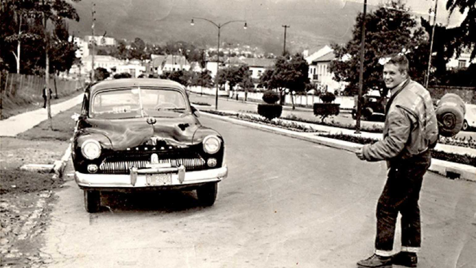 A young man next to a taxi in Ecuador, 1961. Photo courtesy Found magazine.