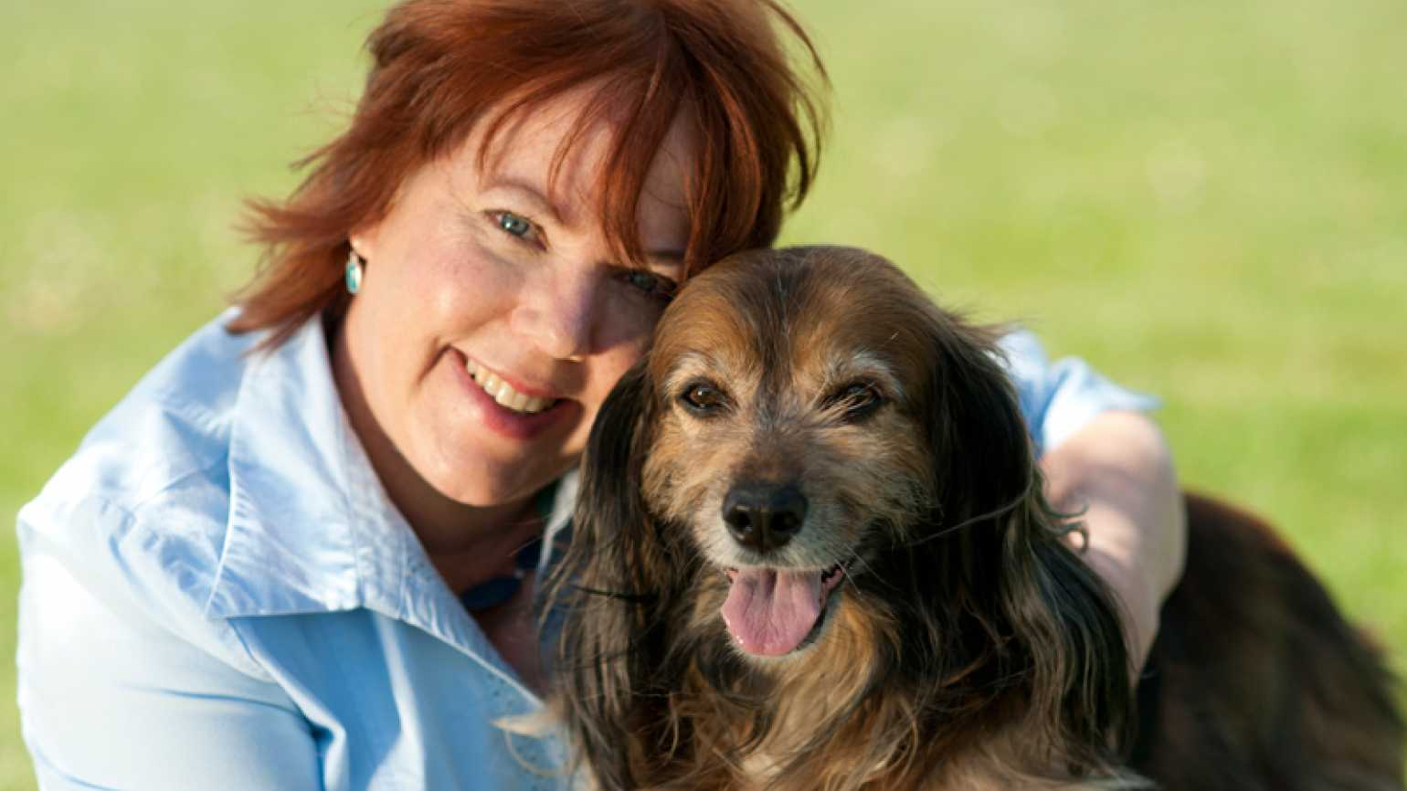 Peggy Frezon with a canine friend