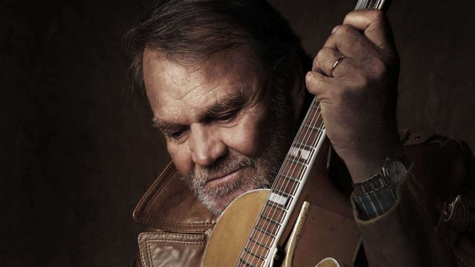 Glen Campbell holding a guitar