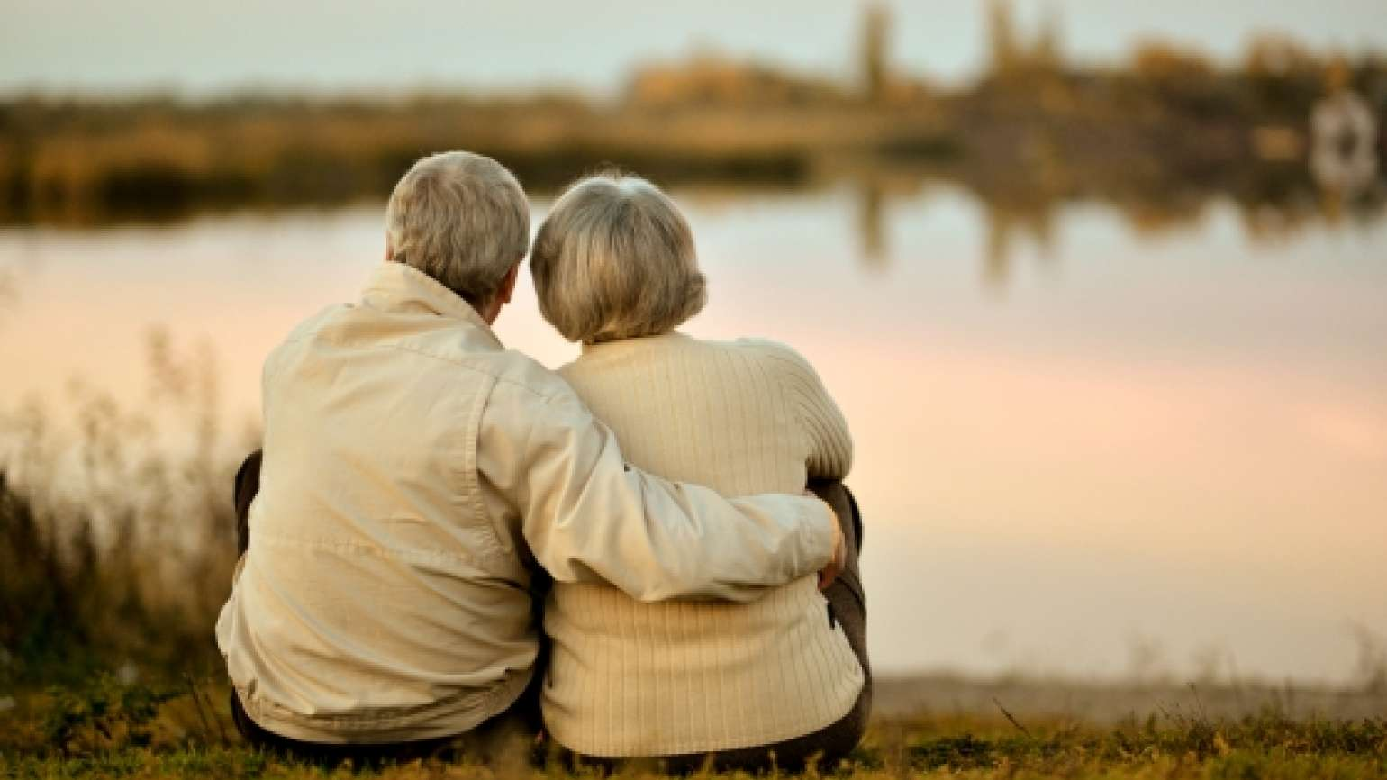 Older couple watching the sunset