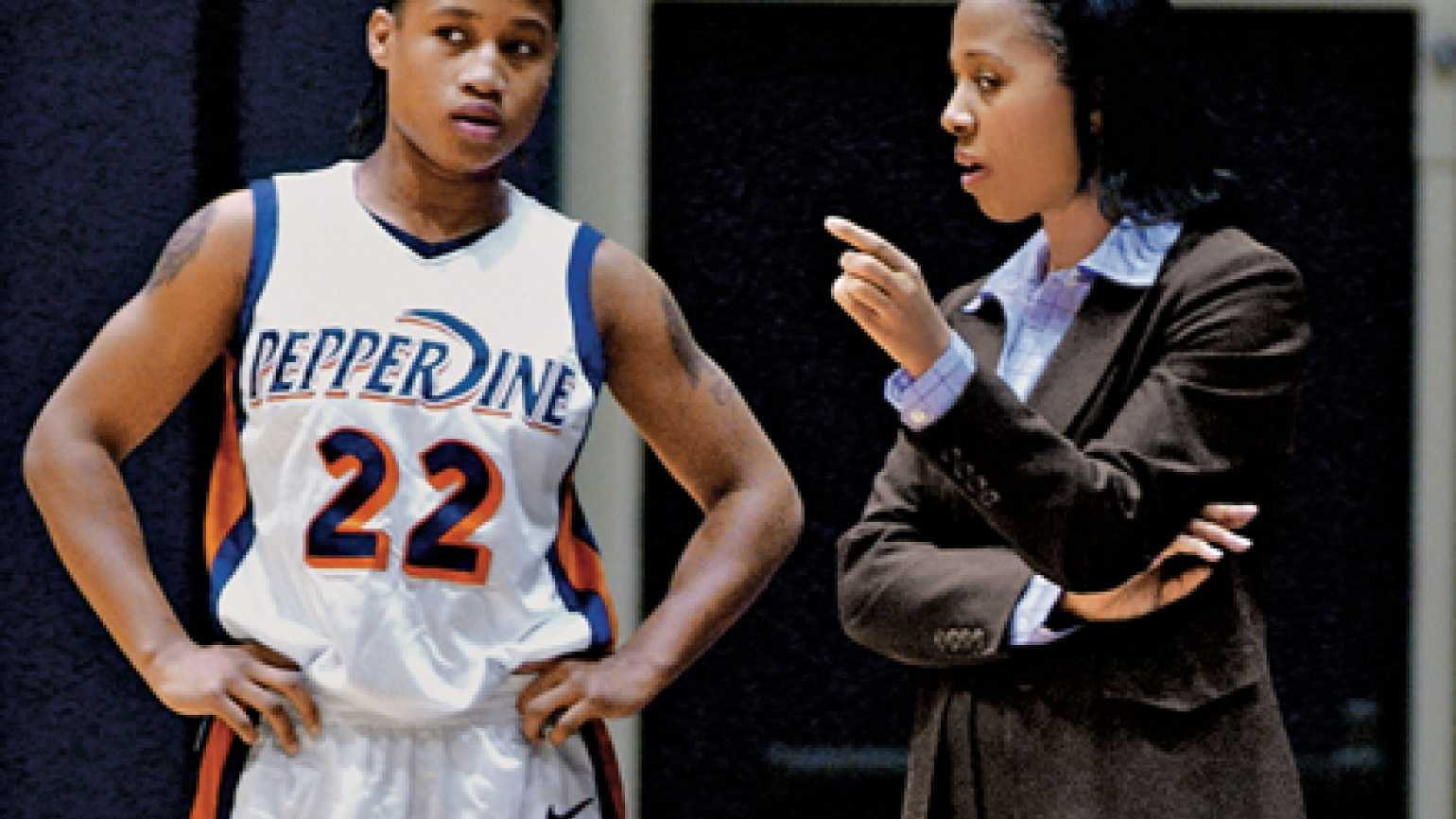 Coach Rousseau offers guidance to one of her Pepperdine players.