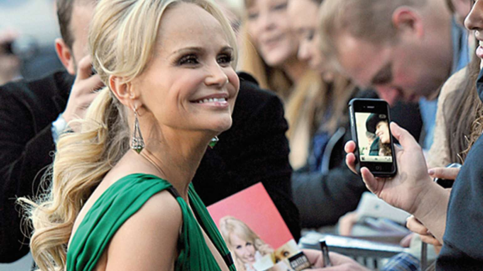 Kristin Chenoweth sign autographs and poses for pictures for her fans.