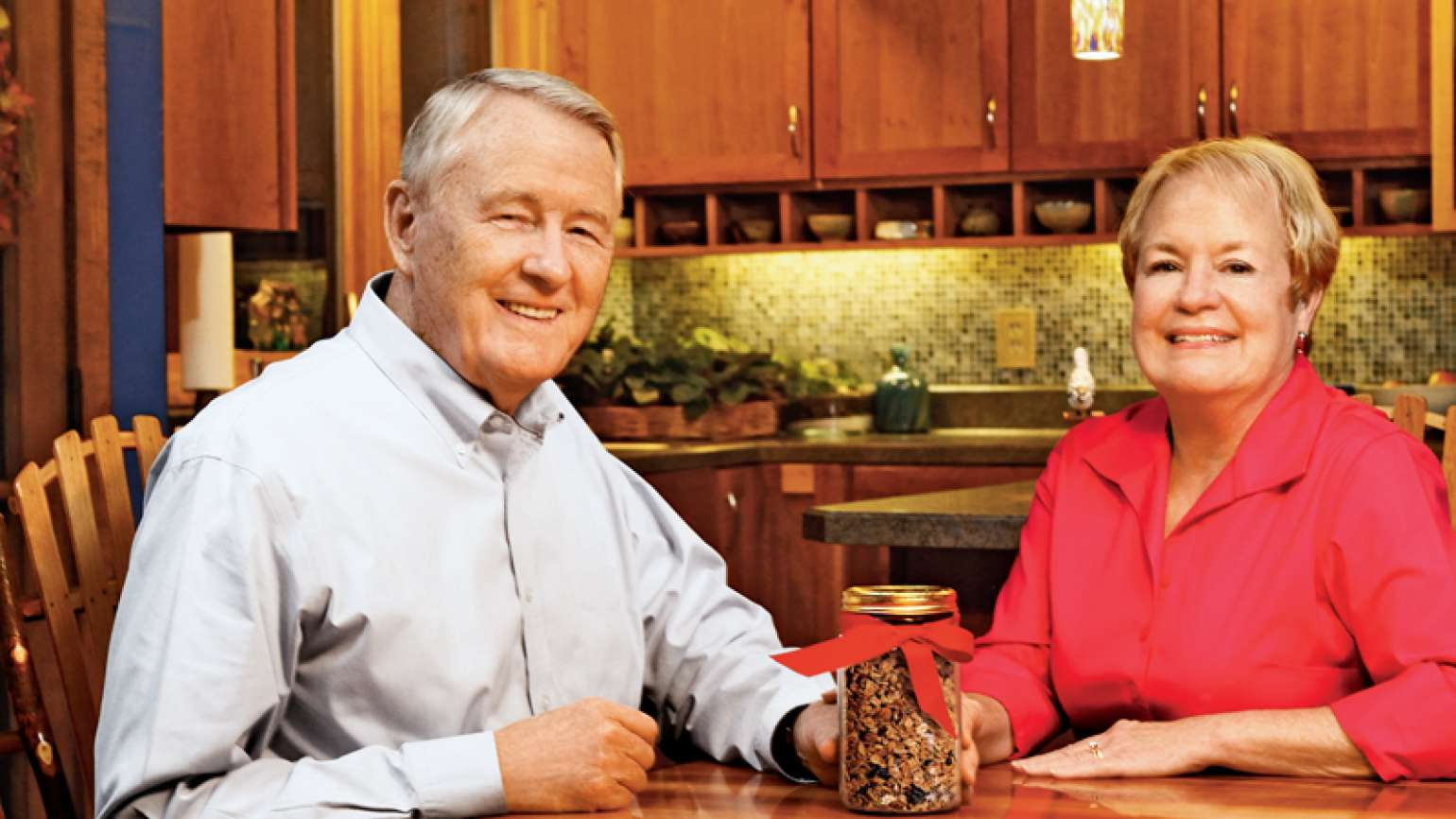 Leon Burns with his wife, Julie, and a jar of his special granola