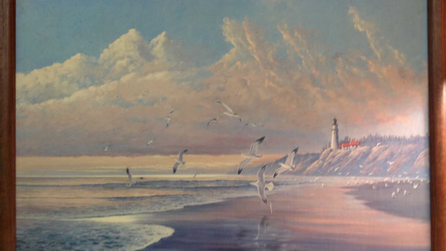 A painting of a lighthouse on the beach from Publishers Clearing House