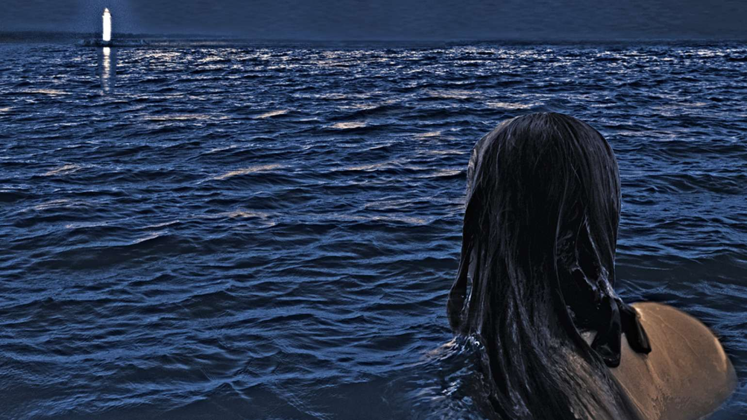 A woman treading water in the ocean gazes at a distant lighthouse.