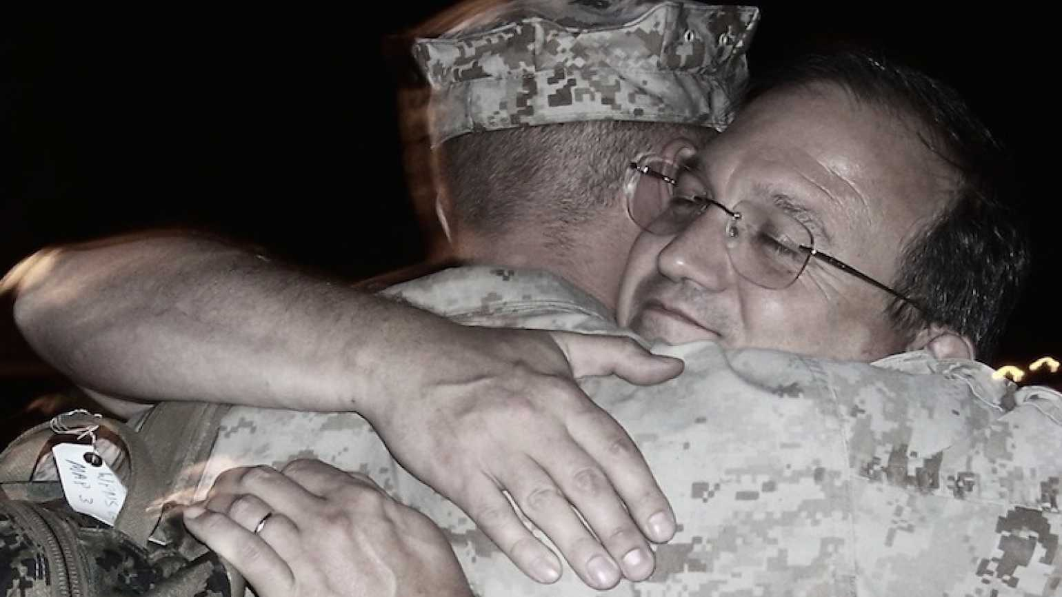 Edie's son Kirk, off for his first Iraq deployment, gets a hug from his dad.