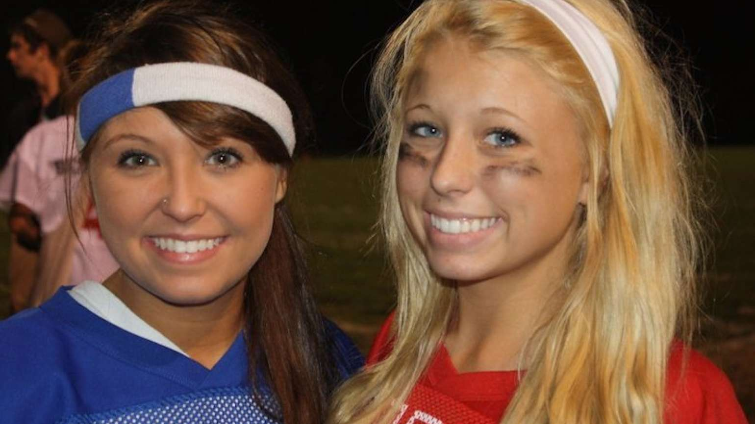 Michelle Adams's daughters in a Kodak moment at powder puff football game.