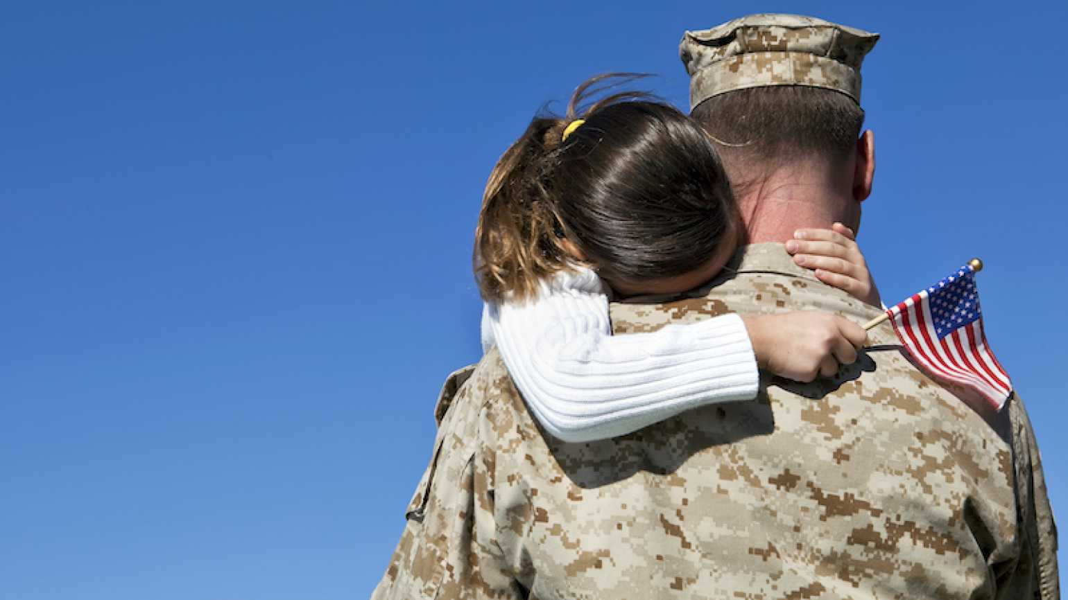 A soldier hugs his daughter. Photo by videodet for Thinkstock, Getty Images.