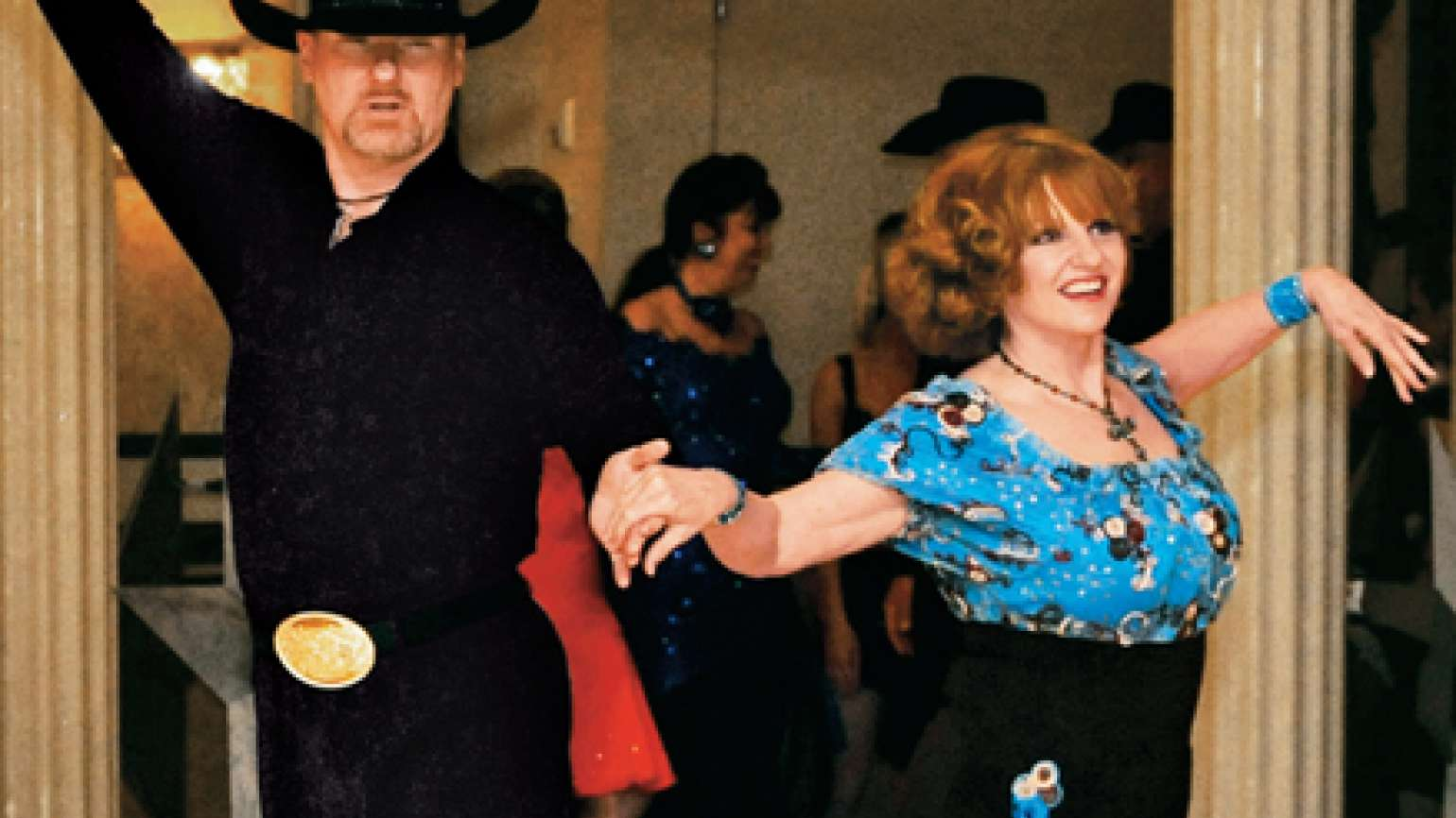 Merry Keller and her dance partner, Bob Clanton, keep in sync.