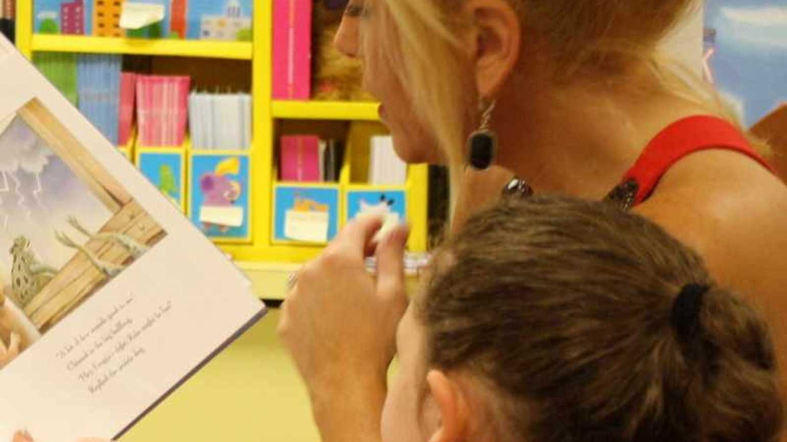 Inspirational Stories blogger Michelle Medlock Adams reading to a child