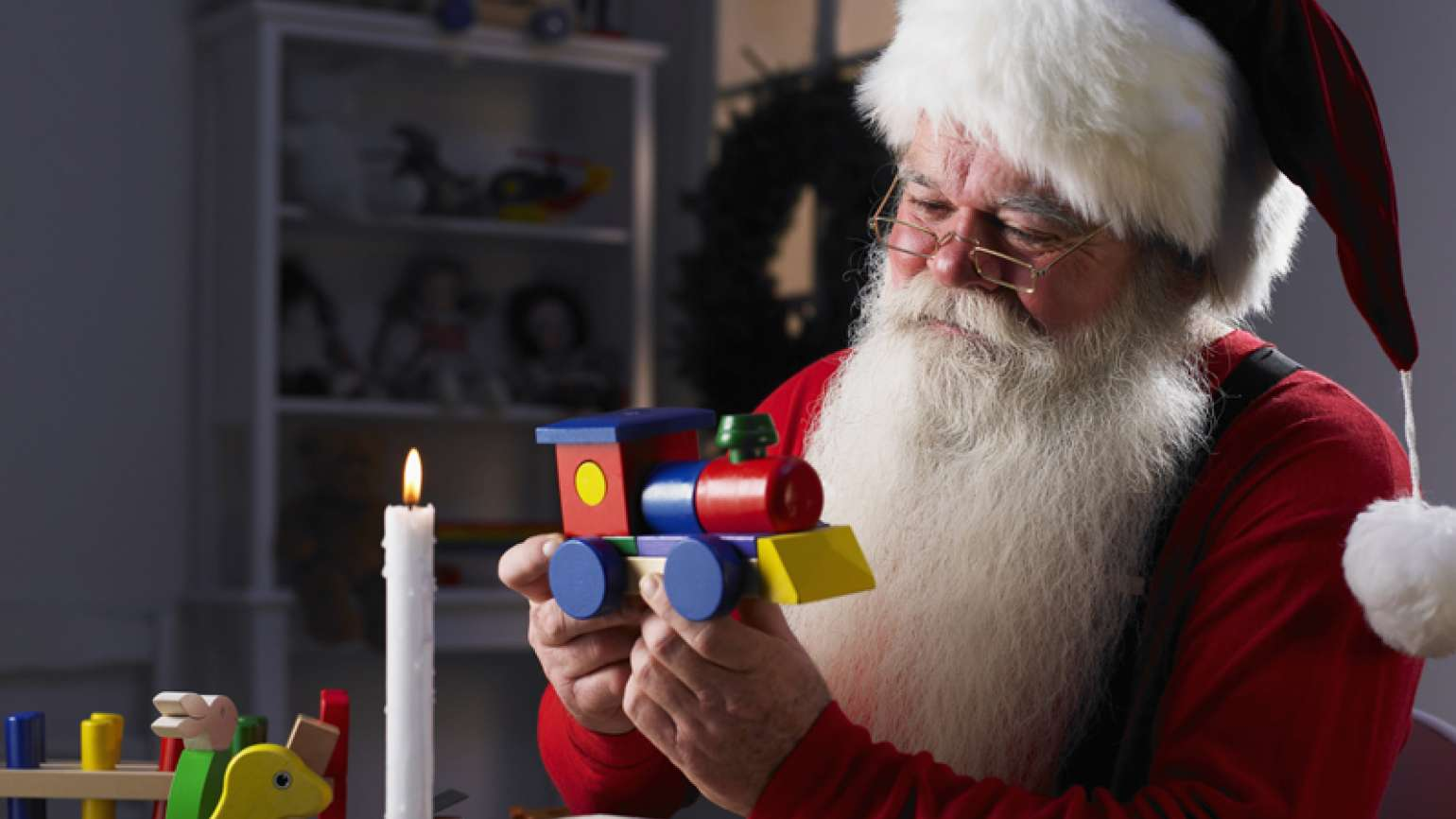 Santa working on a toy in his workshop
