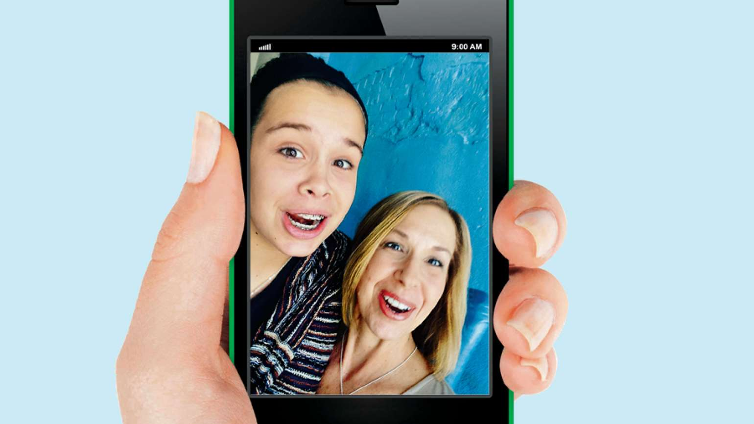 Stephanie and Micah in a selfie on a smartphone screen