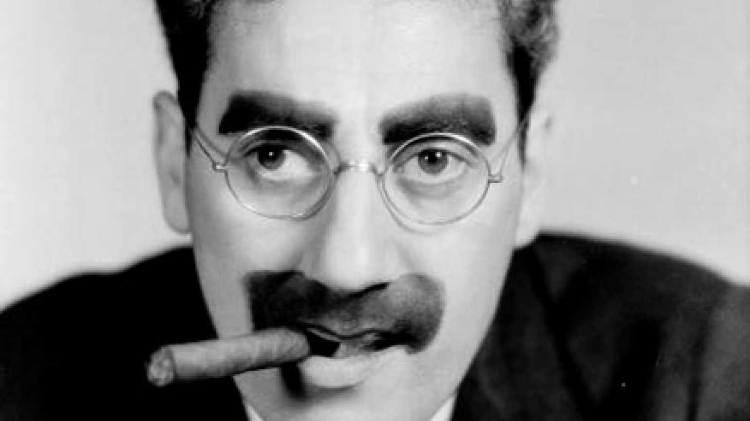 Groucho Marx with a cigar in his mouth