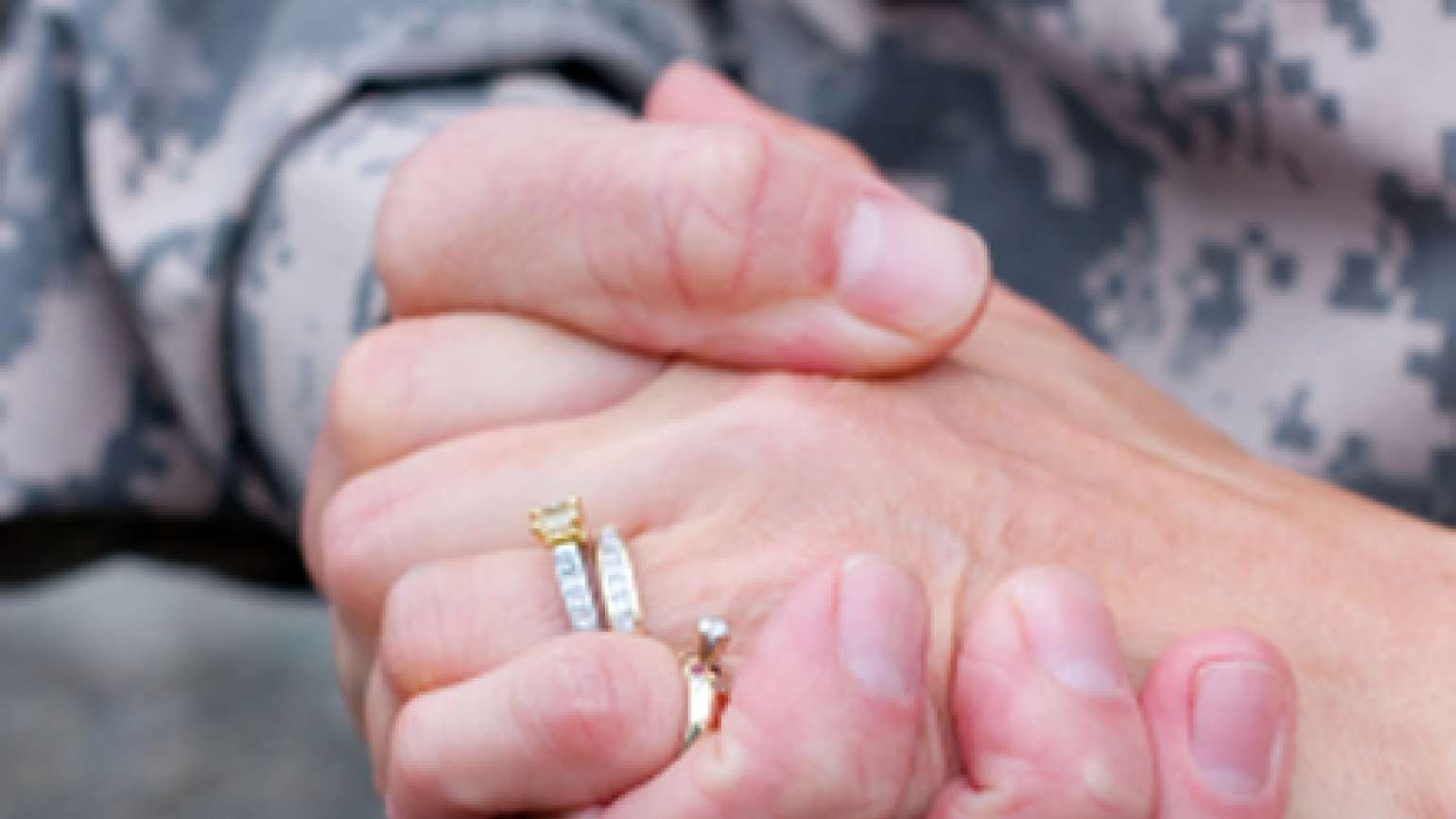 Guideposts: A closeup shot of a soldier's hand clasping his wife's hand