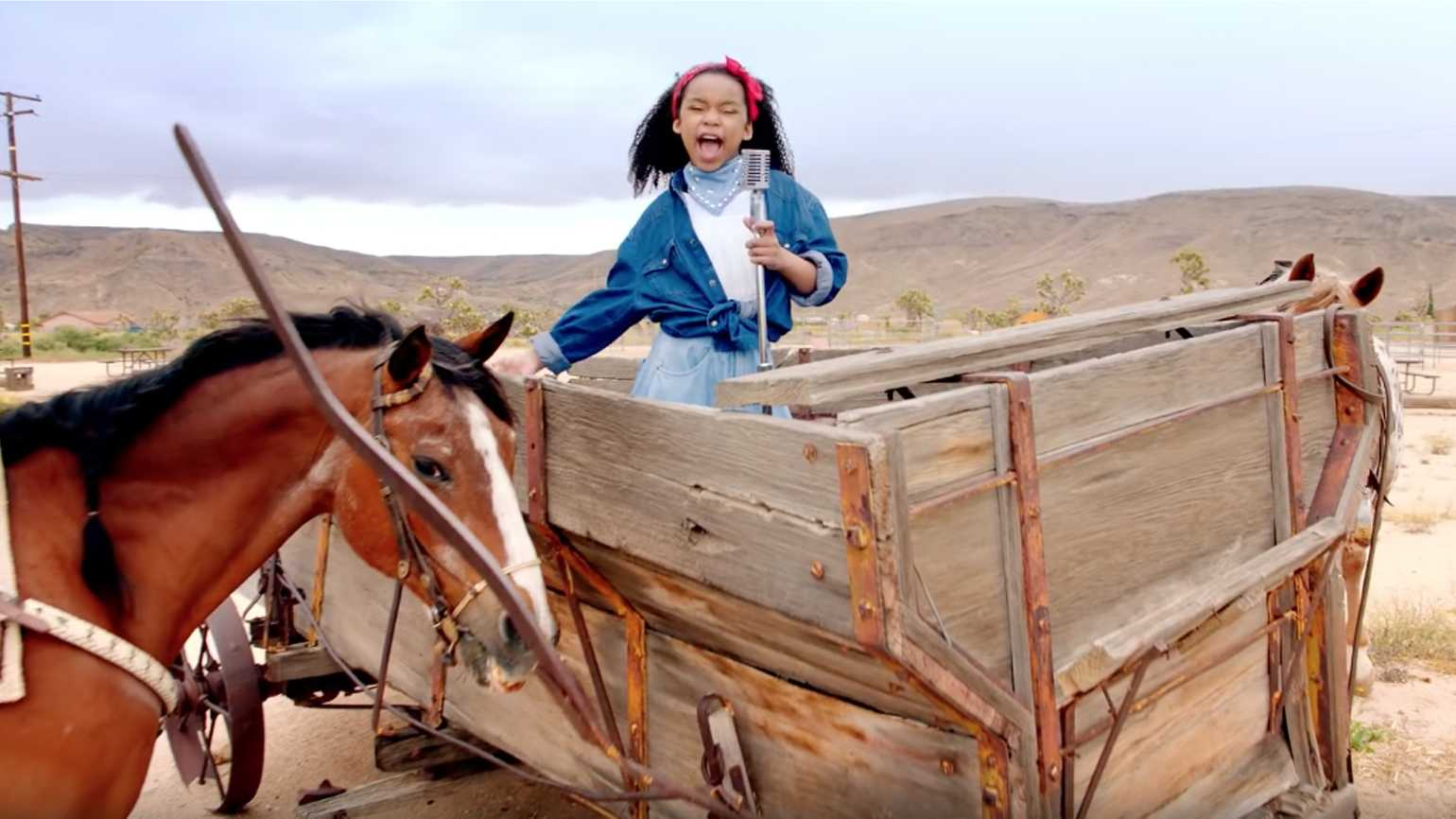 A young  girl singing 'Old Town Road' by Lil Nas X.