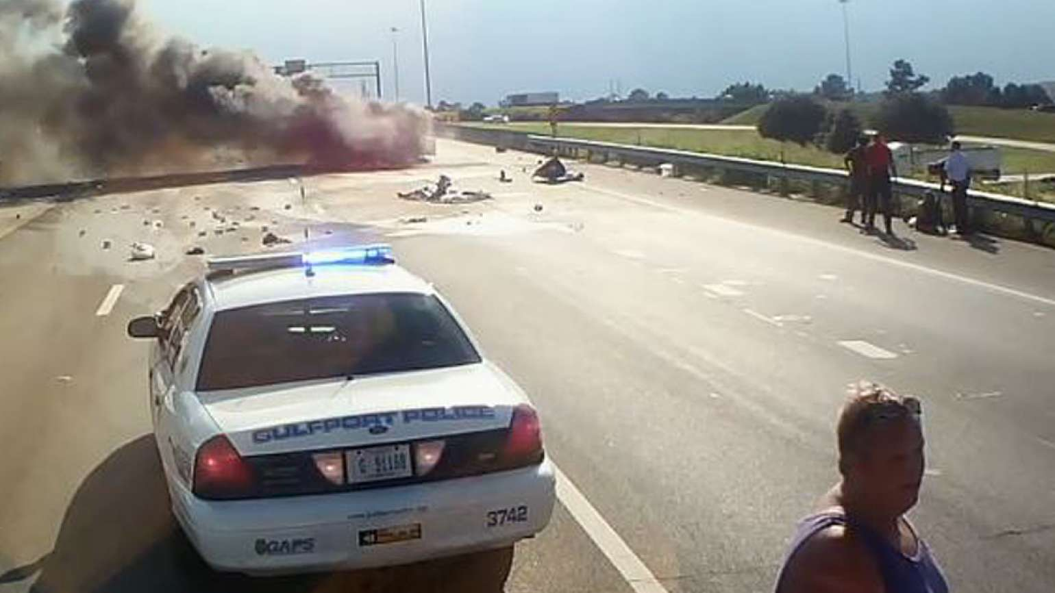 David Fredericksen rushes to help a woman and a child trapped in a burning car.