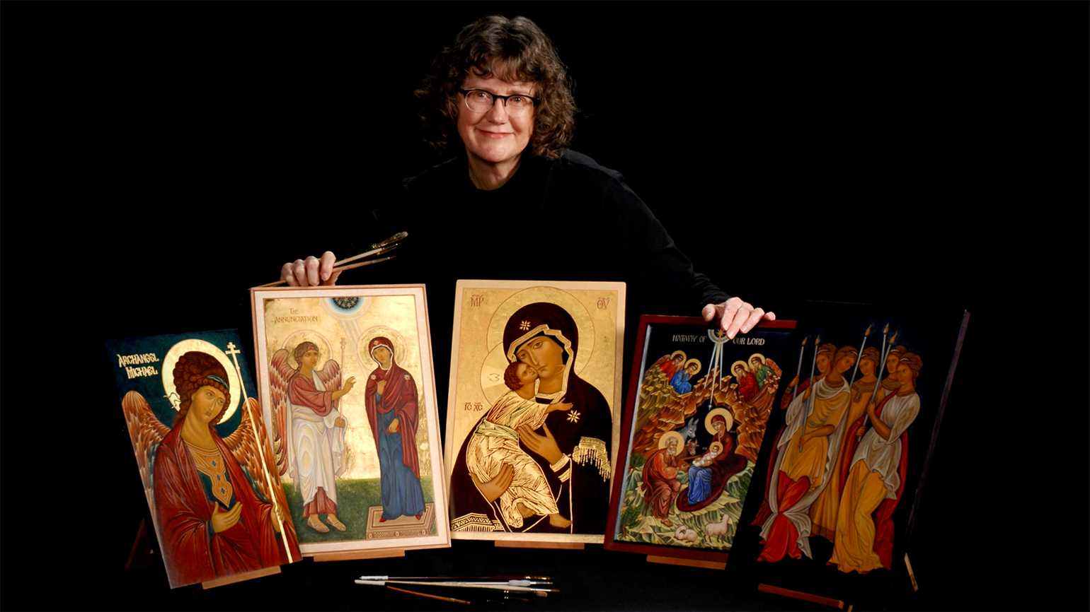 Deborah Anderson with examples of her iconography