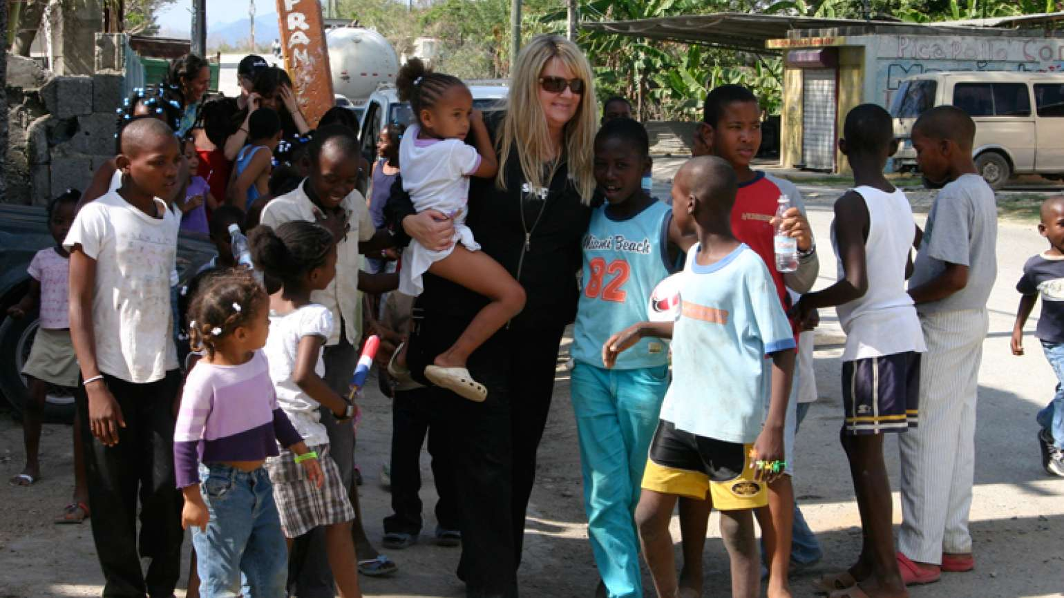 Shelene Bryan strolls with a group of children in the Dominican Republic