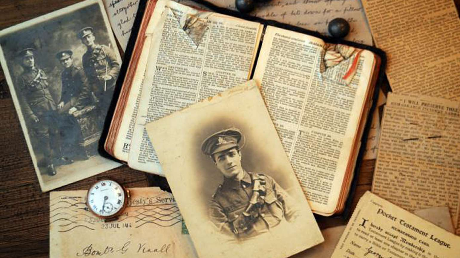 Guideposts: British bombardier George Vinall's battered Bible and three pieces of shrapnel