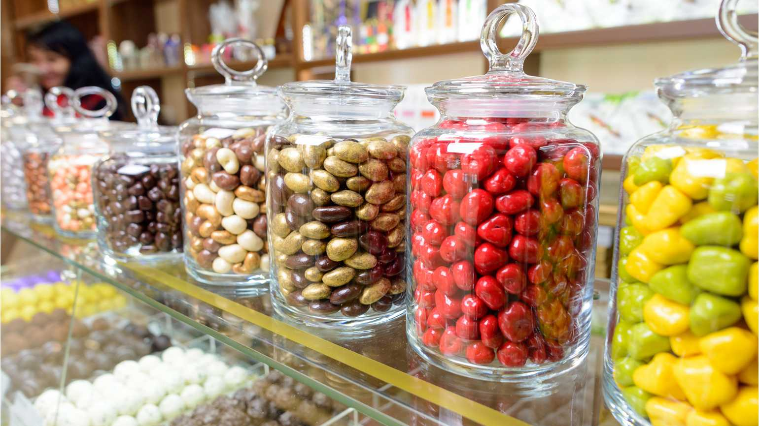 Candy jars filled with various assorted sweets.