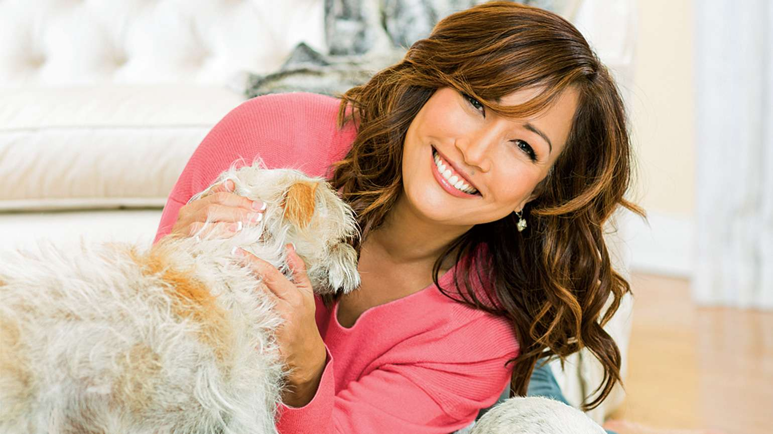 Actress Carrie Ann Inaba with a canine buddy