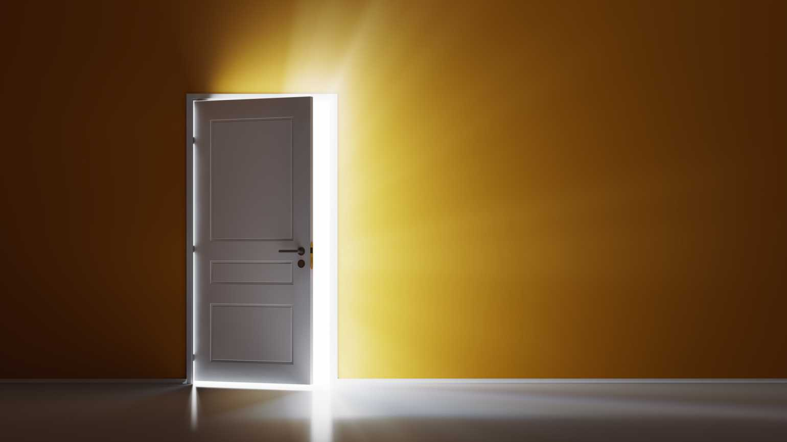 A door cracked open with light streaming through; Getty Images