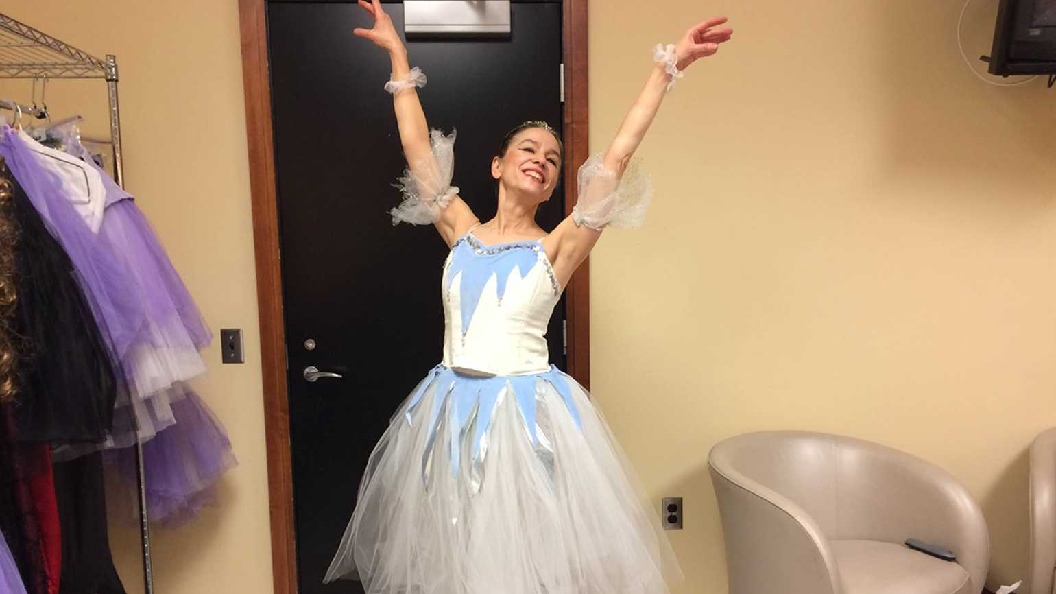 Deborah Novak strike a ballet pose in her dressing room.