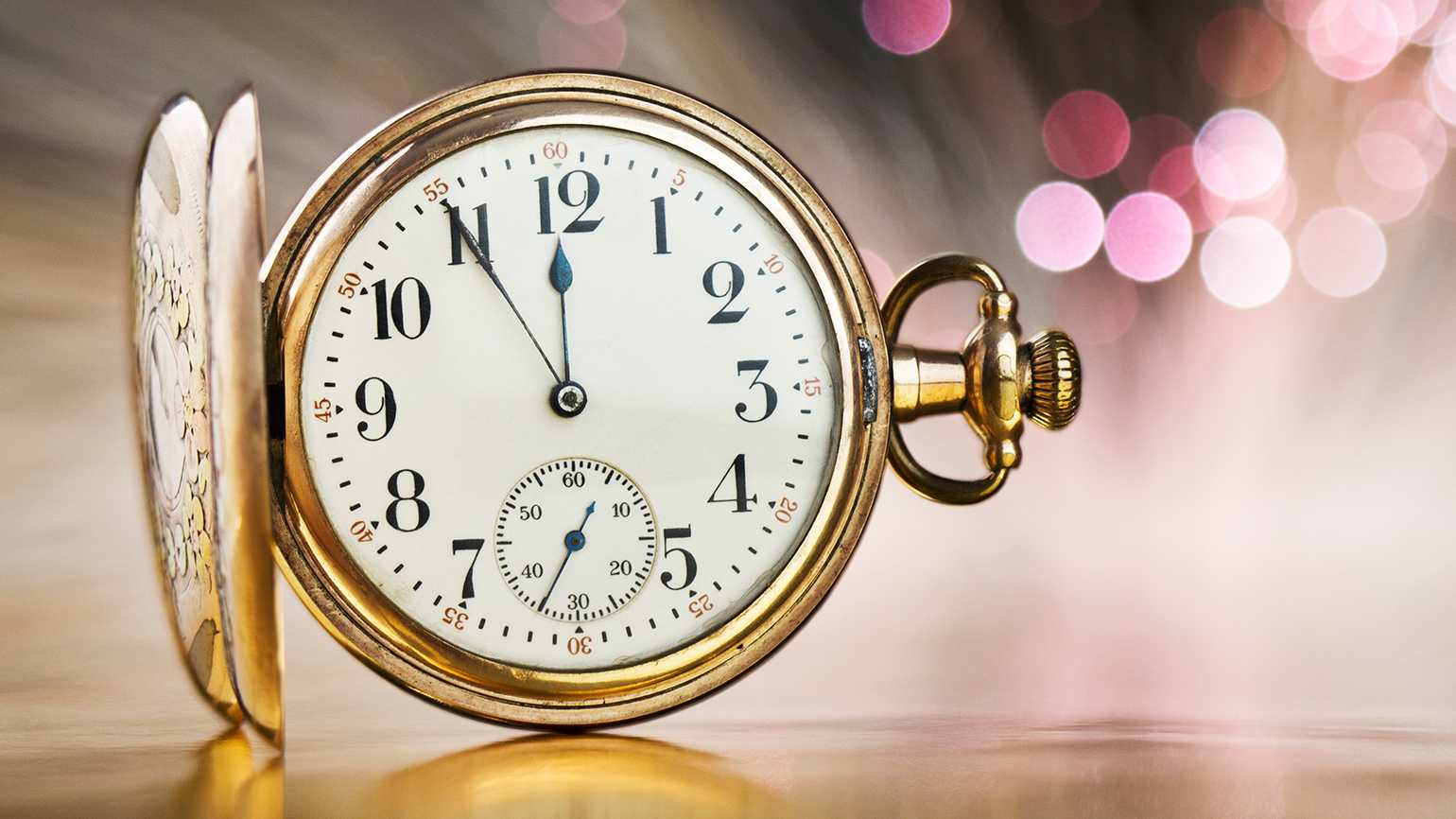 A pocket watch ticks down to midnight and the arrival of the new year