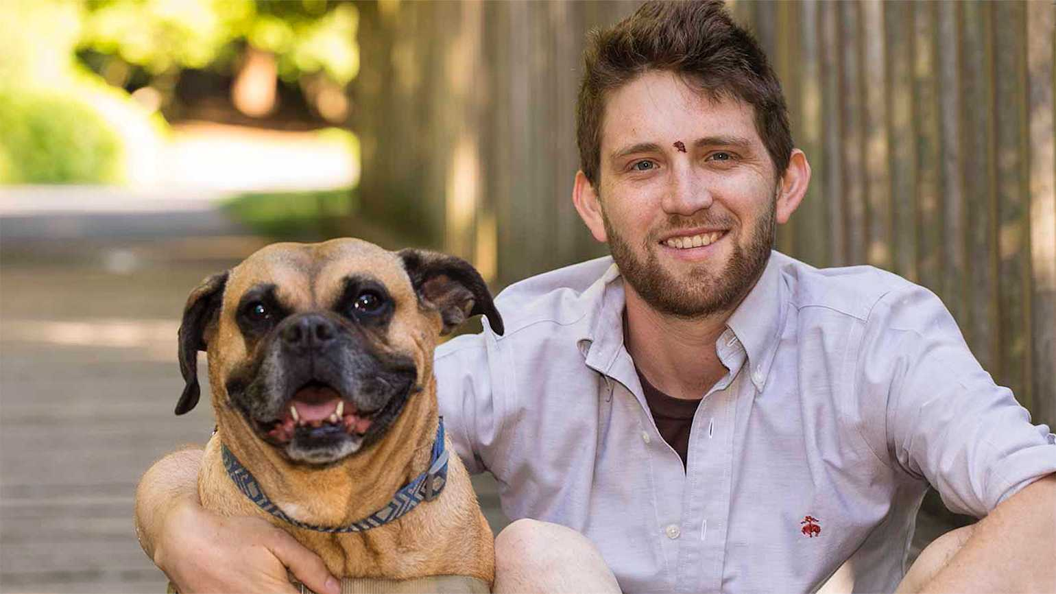 Spencer Roost and his dog, Moon
