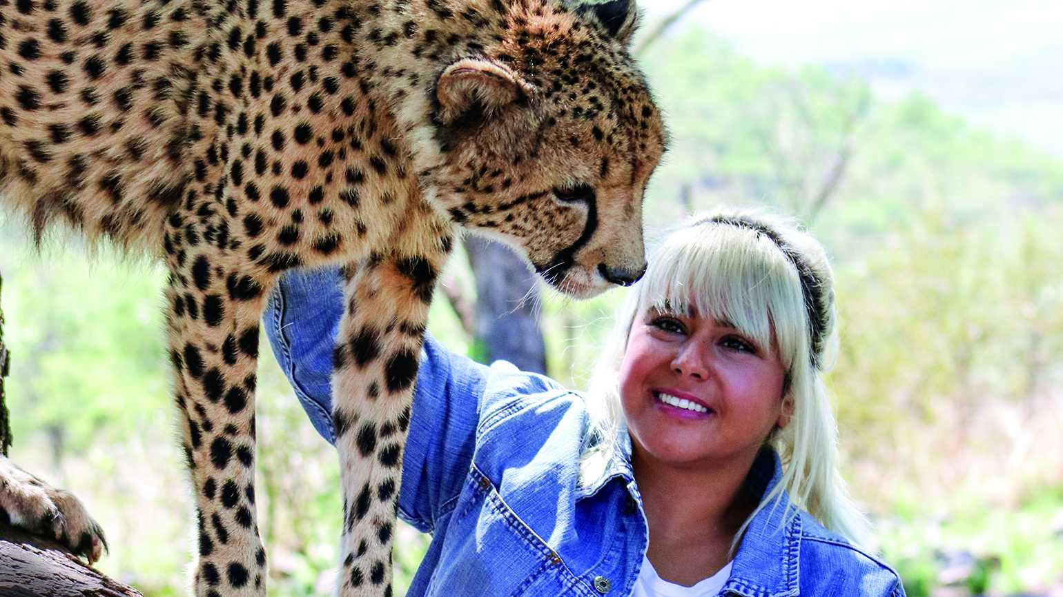Sonia Perry pets a cheetah