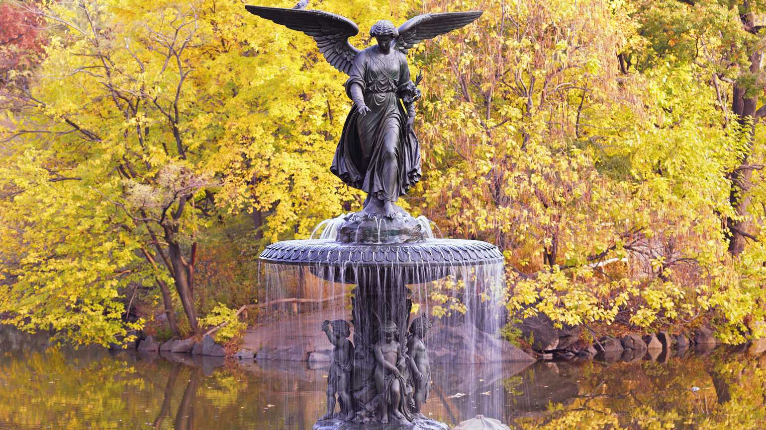 A bronze sculpture of a female winged angel.
