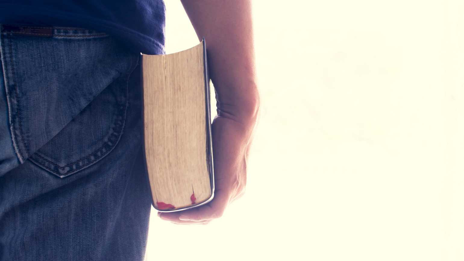 A man holding a Bible in his hand.