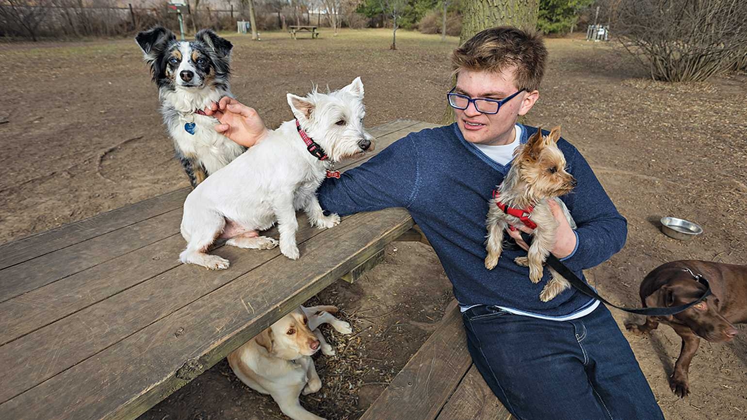 'Caring for dogs has given Caleb a real purpose in life,' his mom says