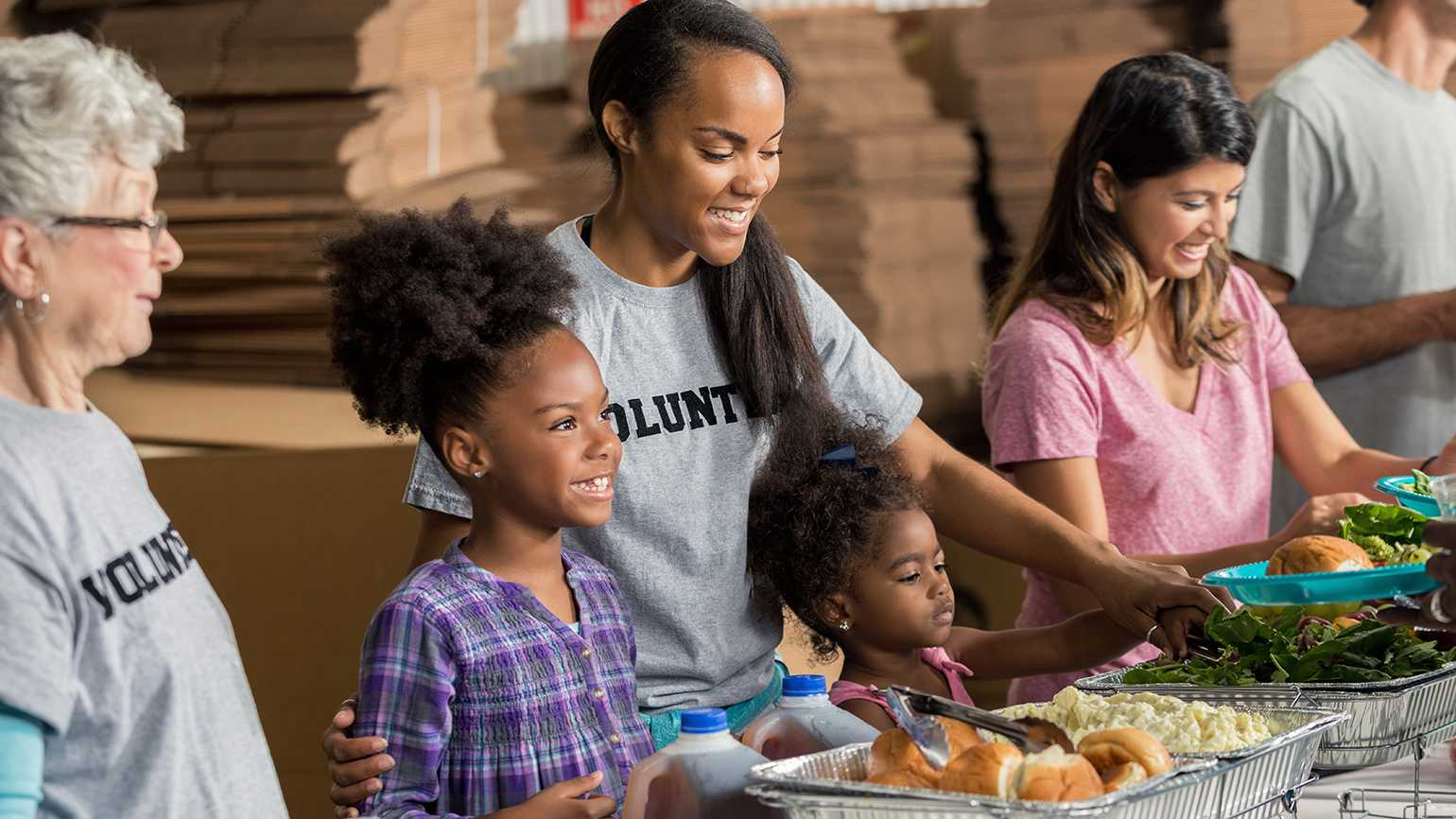A family volunteers at a food pantry