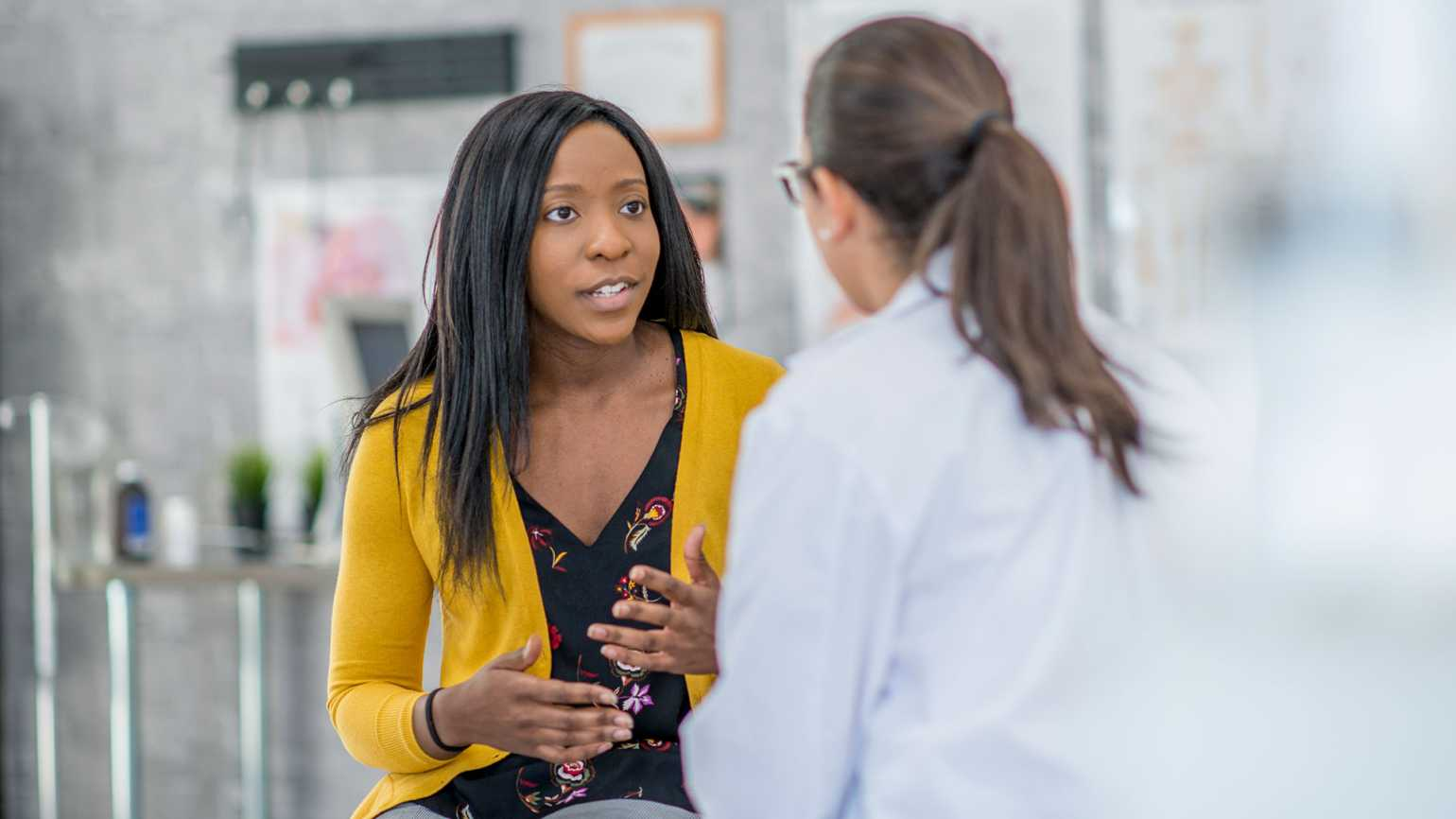 A woman consults with her doctor