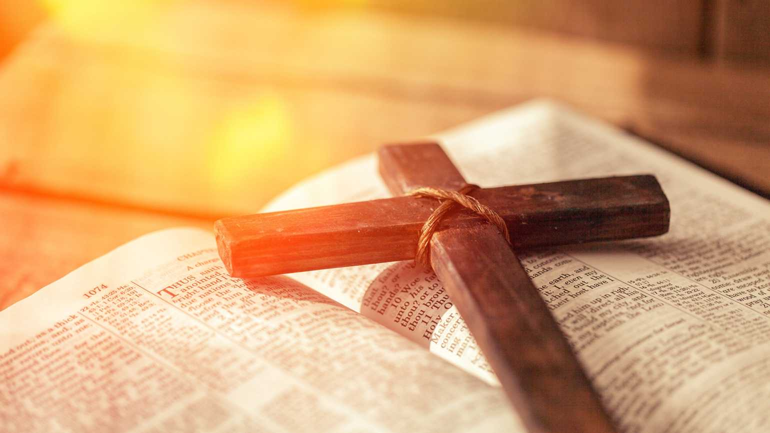 Wooden cross on a Bible; Getty Images