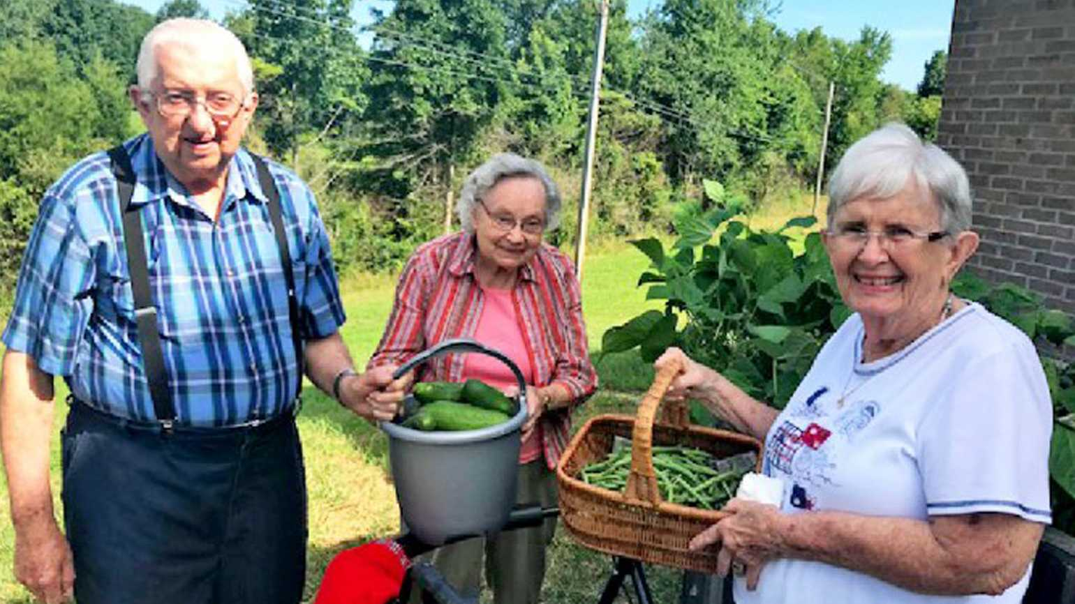 Billie Sakel (right) and her friends Lenus and Sarah Weisheit harvest vegetables from the garden areas at Northwood Retirement Community in Jasper, Indiana.