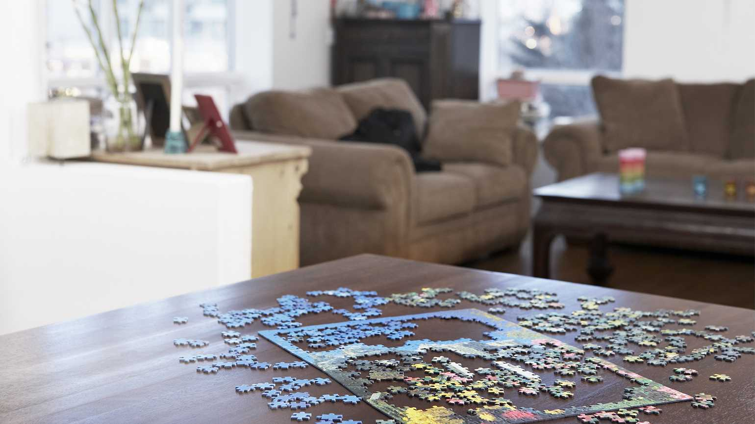 A teenager doing a jigsaw puzzle.