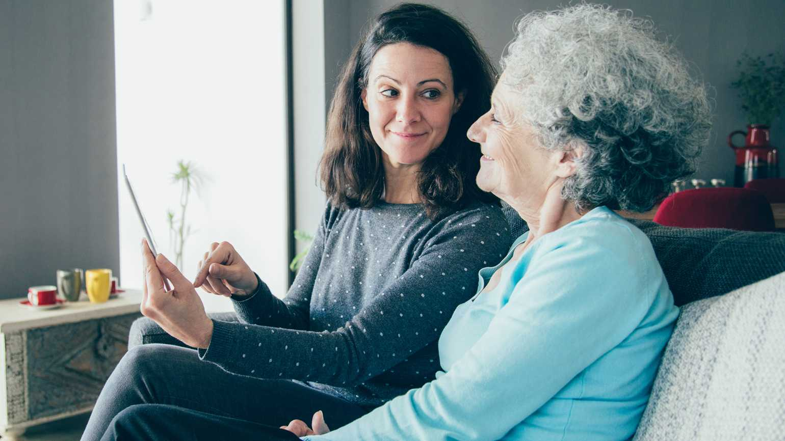 A woman in her golden years spending time with her daughter in their home.