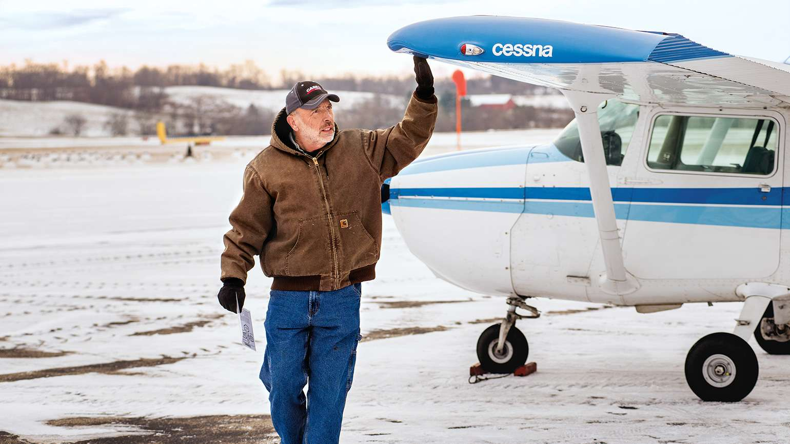 Joe conducts a preflight check of a Cessna 172.
