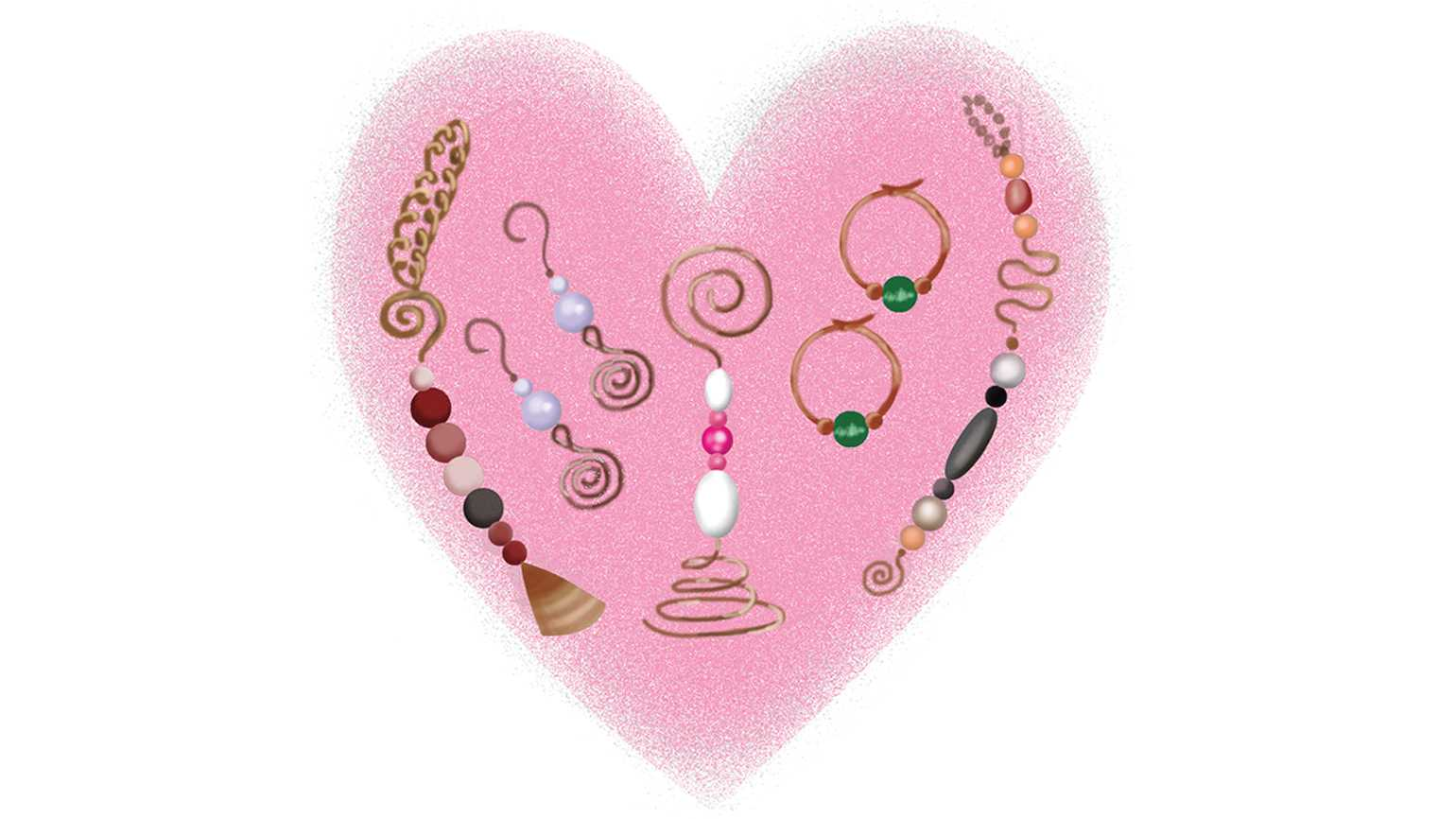 A pink heart with assorted handmade jewelry.