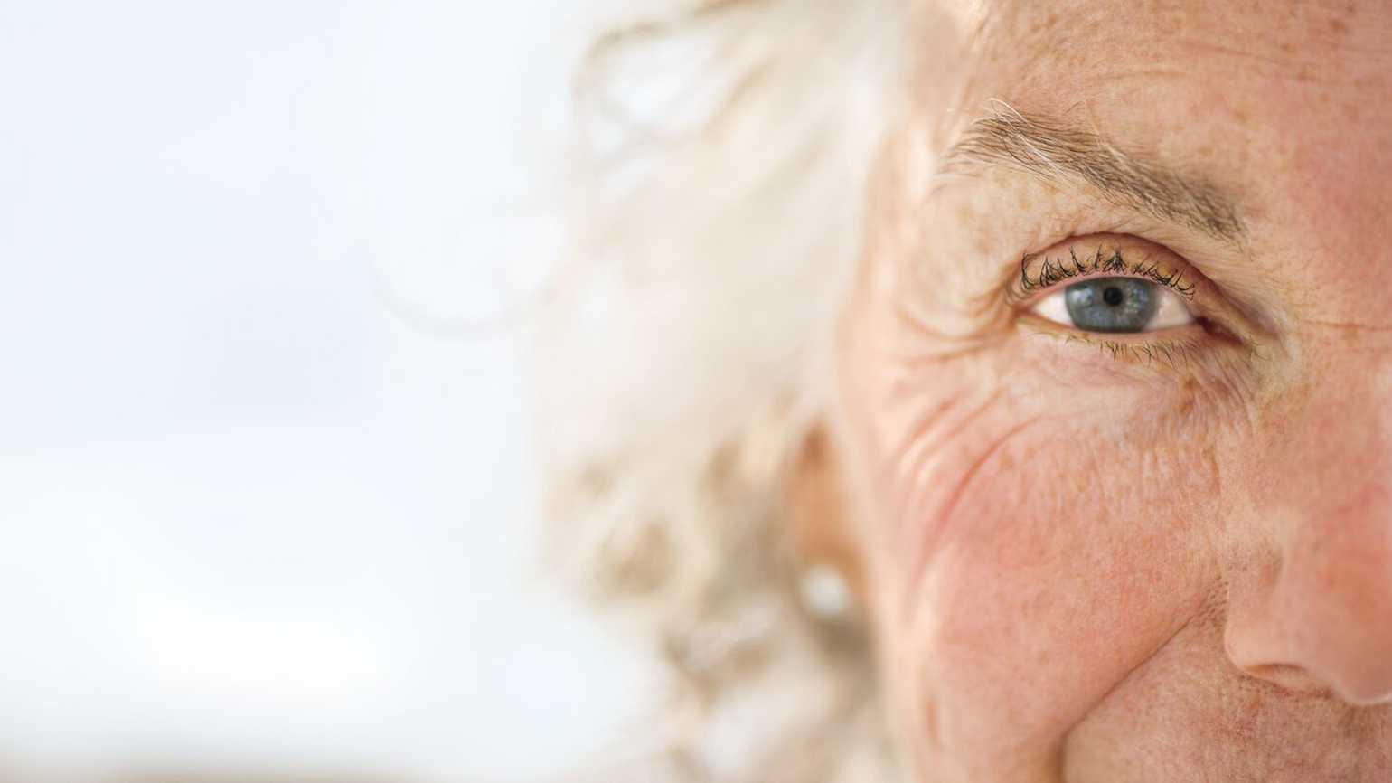 A close up of an aging woman's left eye.