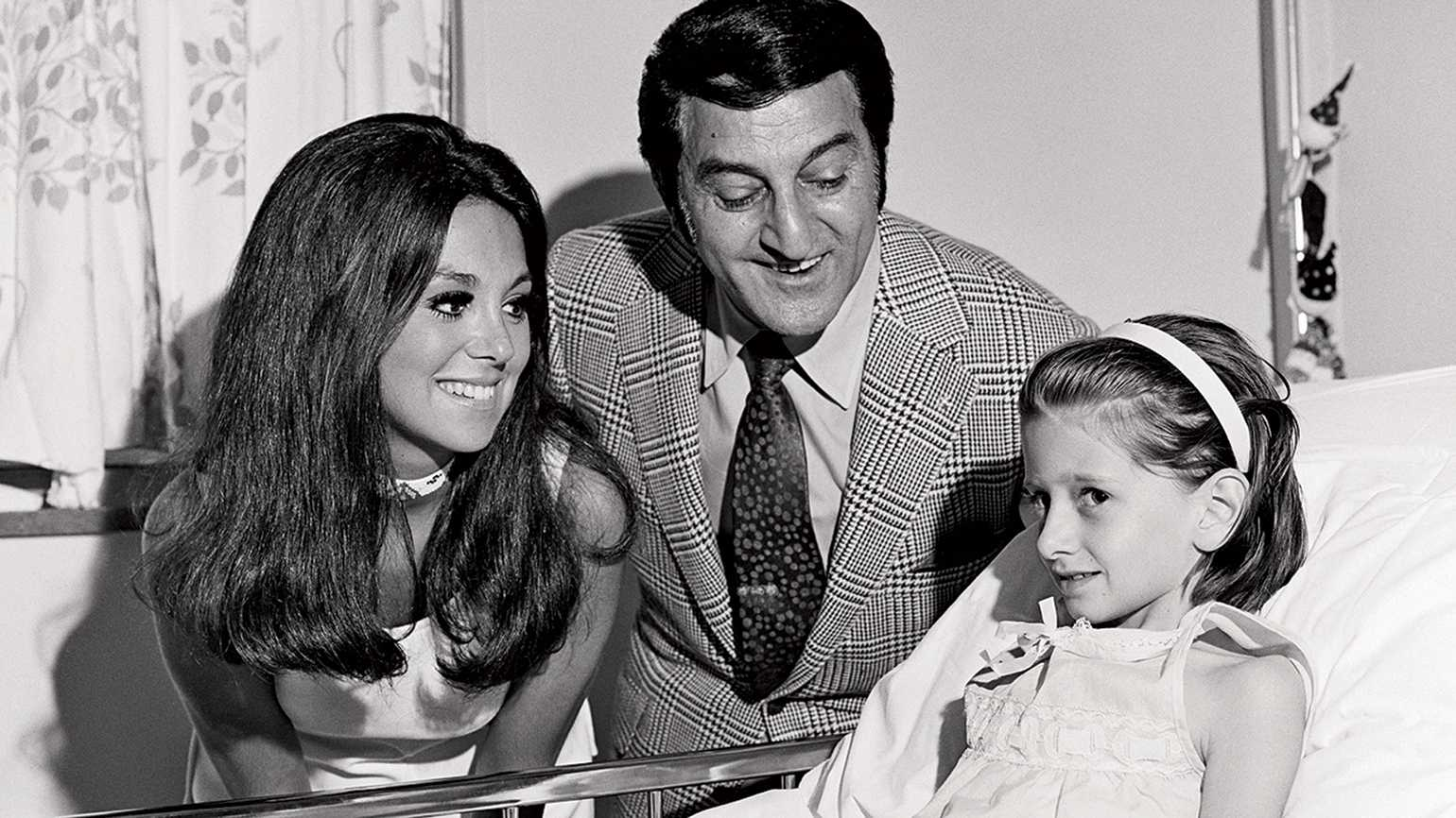 Marlo and her father visit one of the young patients at St. Jude's